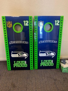 Seahawks Fire Pit and professionally painted metal Seahawks corn hole game.